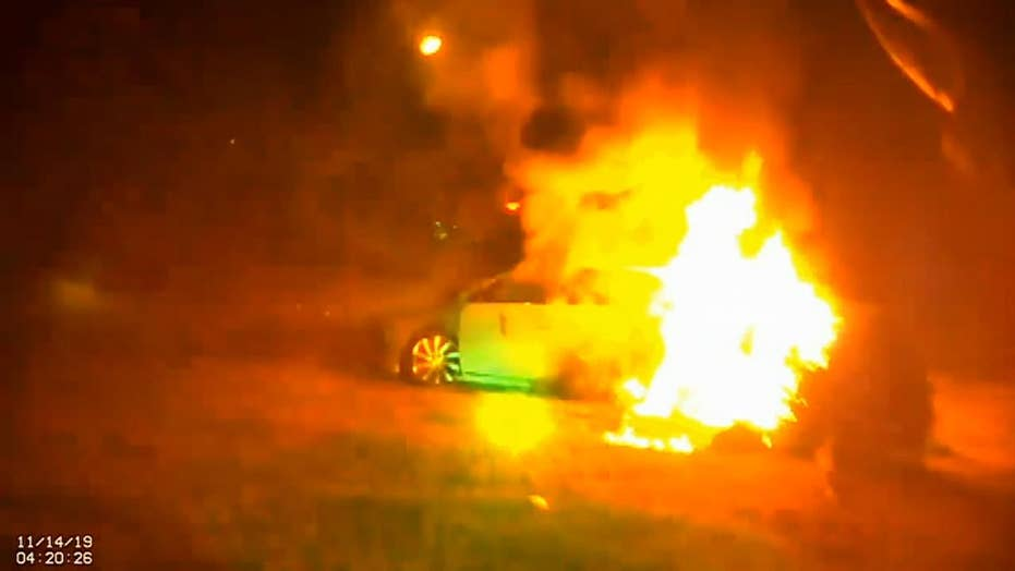Police cut out Virginia woman from burning car before flames engulf the vehicle