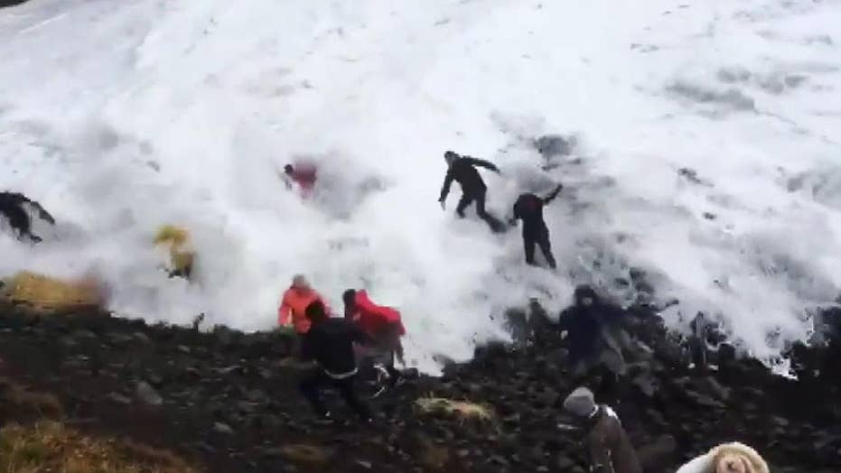 Wave catches tourist off guard at Iceland's iconic Reynisfjara Beach