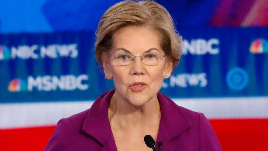 Warren pushes wealth tax plan at debate stage