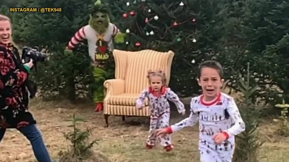 Hilarious video: Grinch scares children taking Christmas photos