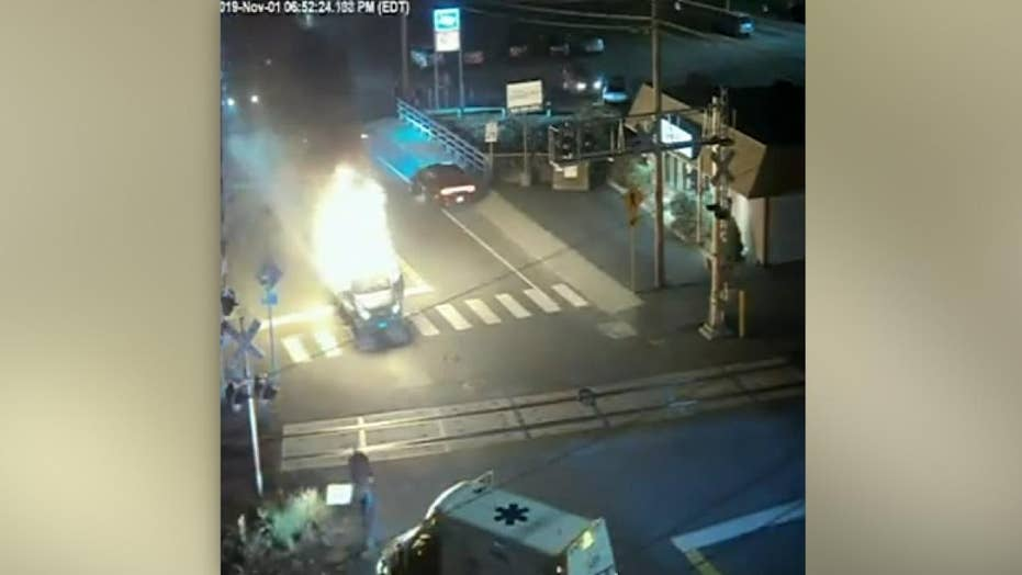 Hero saves man from burning car in Connecticut