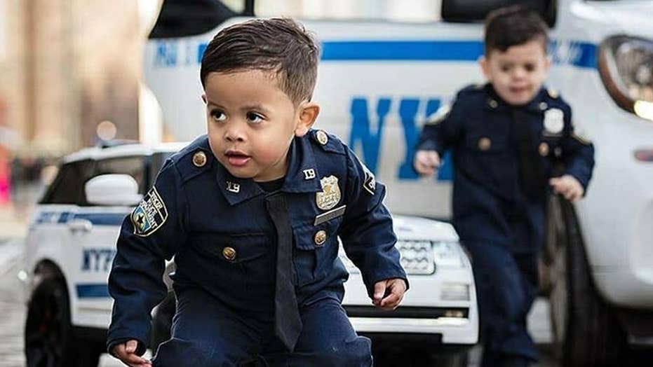 Adorable toddler 'NYPD lieutenant' twins travel the country to honor police officers and those who serve