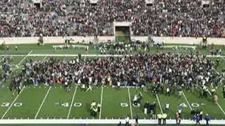 Harvard-Yale football game delayed after climate activists storm field