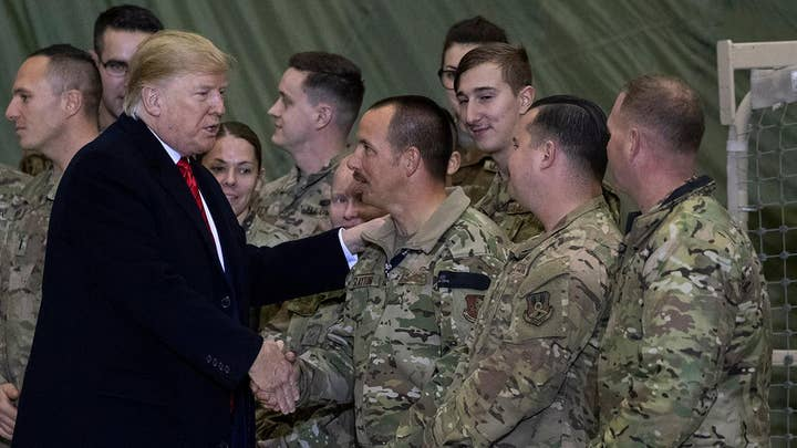 Trump says US will resume peace talks with Taliban during surprise Afghanistan visit