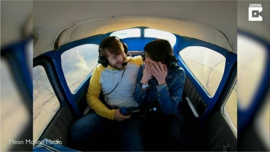 WATCH: KY man proposes to woman during intimate plane ride