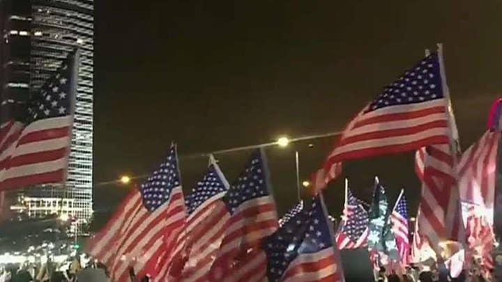 Hong Kong protesters praise Trump, wave American flags