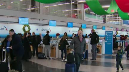 Millions of Americans under winter weather alert on one of the busiest travel days of the year