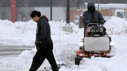 Major winter storm slams Northeast, grounds hundreds of flights