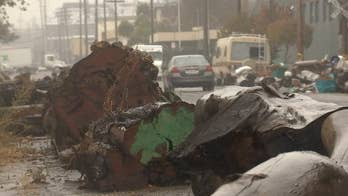 Logs placed on Oakland street in apparent attempt to deter homeless from parking vehicles