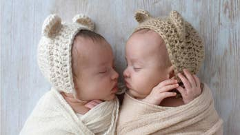 Mom's heart 'burst with love' when she caught twin baby sons hugging in crib