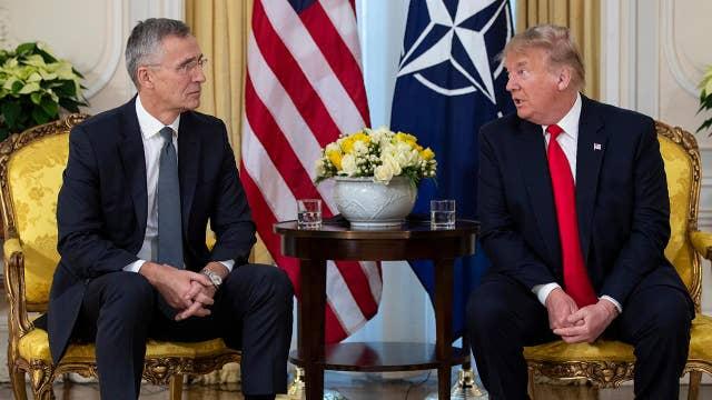 Trump blasts Democratic impeachment push during NATO press conference