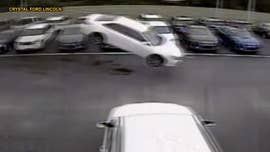 Watch: Toyota Camry jumps 139 feet into parking lot after driver loses control