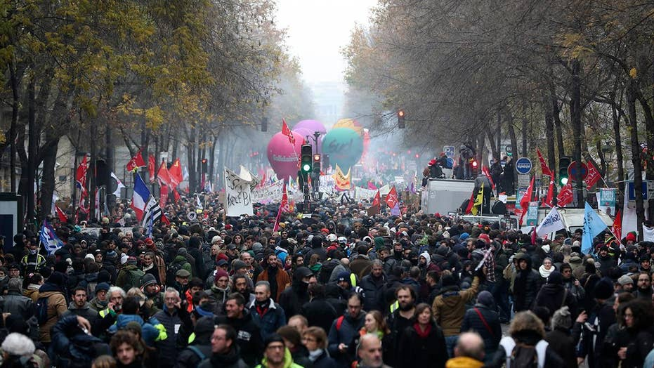 Pension protesters in Paris disrupt transit, close schools and Eiffel Tower