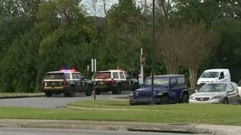 Naval Air Station Pensacola shooting witness heard about a dozen shots
