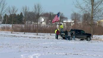 Flag raised near scene of Minnesota National Guard helicopter crash