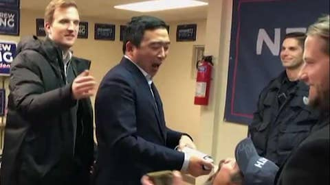 Andrew Yang sprays whipped cream in supporters' mouths