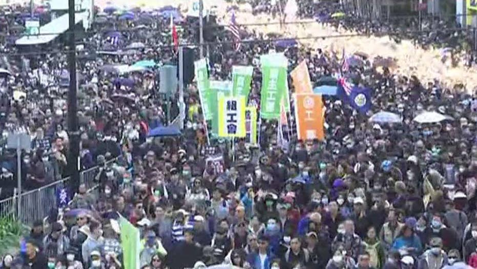 Hundreds of thousands participate in first government-approved march in Hong Kong since August