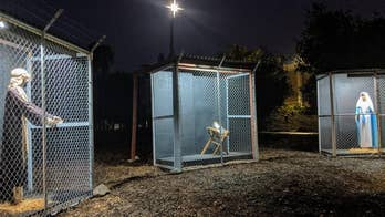 Nativity scene shows Jesus, Mary and Joseph as refugees separated in cages