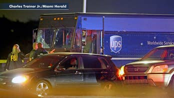 Police conduct questioned after two civilians killed in shootout with UPS truck hijackers