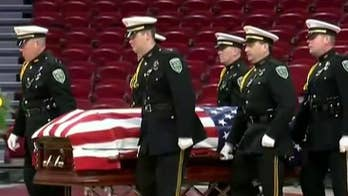 Arkansas officer honored and laid to rest after being 'ambushed and executed' in his patrol car