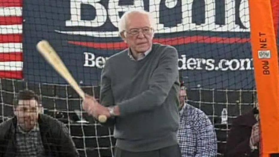 Bernie Sanders holds batting practice while meeting with Minor League Baseball players