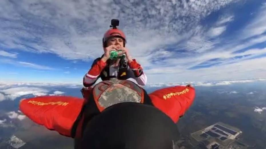 WATCH: Skydiver pulls out burger while skydiving