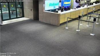Pickup truck crashes through Florida airport's baggage claim area, slams into rental car counter