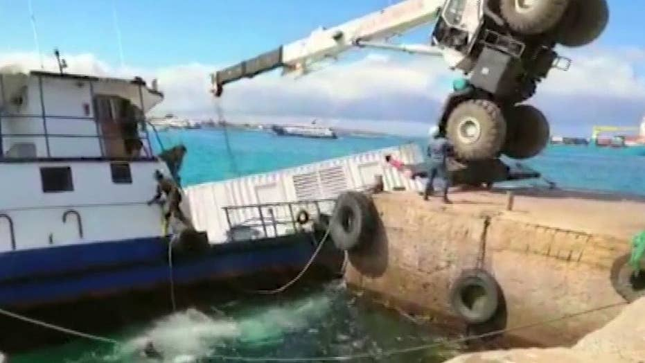Barge sinks while unloading cargo near Galapagos Islands