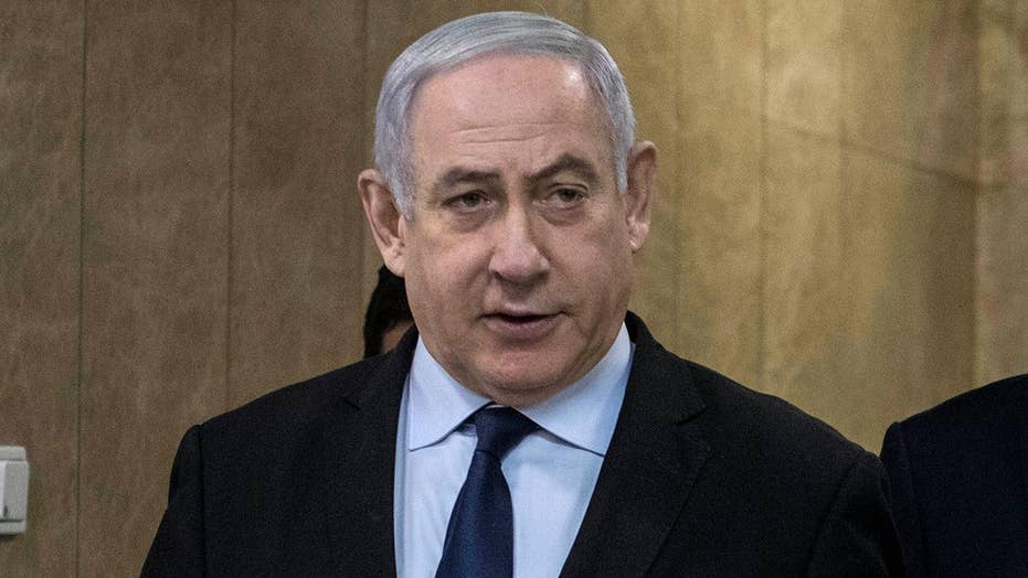 Israeli PM Benjamin Netanyahu evacuated from campaign event during rocket attack in southern Israel