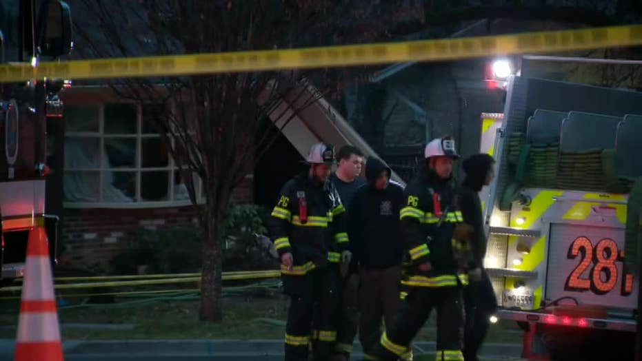 Raw video: First responders cordon off Maryland home that was struck by small plane