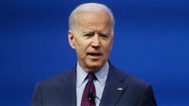 Hecklers derail Biden during New Hampshire campaign event