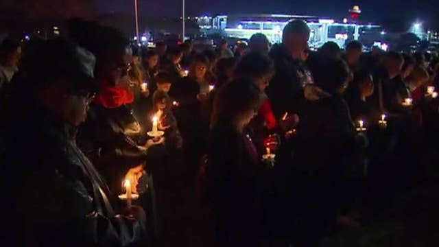 Texas church shooting: Dozens gather for candlelight vigil for victims