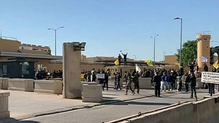 Iraqi protesters break down U.S. Embassy gate