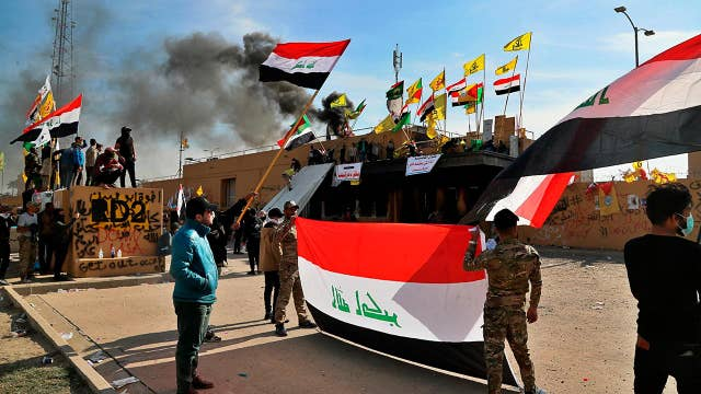 Iran-backed militiamen withdraw from siege of US Embassy in Baghdad as more American troops deployed
