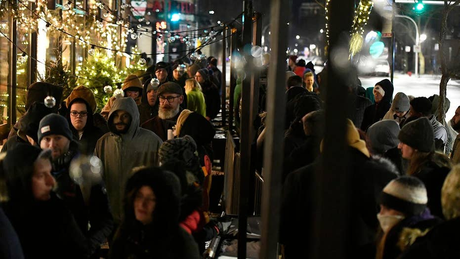 Thousands line up to buy marijuana as Illinois becomes 11th state to legalize pot