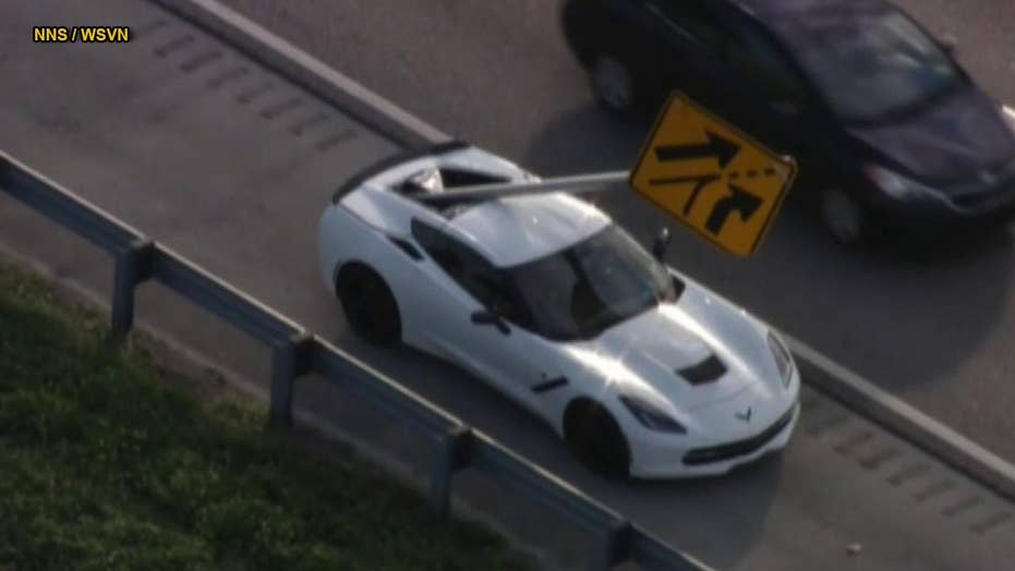 Flying highway sign impales Chevrolet Corvette in Florida