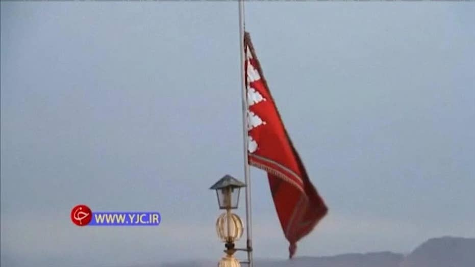Red flag unfurled above mosque following killing of top general Qassem Soleimani