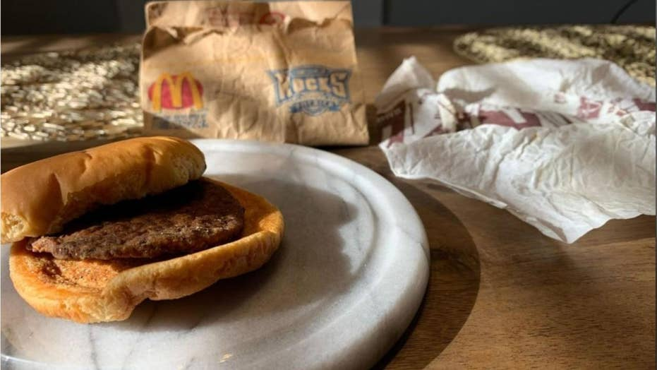 A Utah man unveils a hamburger he purchased from McDonald's in 1999