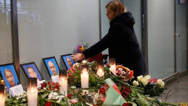 Makeshift memorial in Ukraine pays respect to crew members killed in plane crash