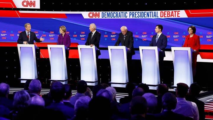 Democratic candidates slam Trump trade deals at Iowa debate