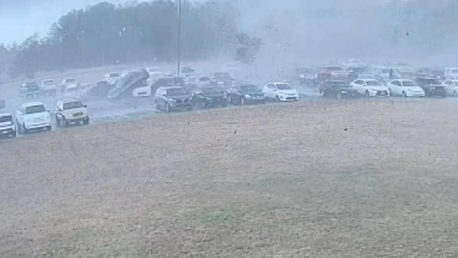 Tornado flips cars while tearing through high school parking lot in South Carolina