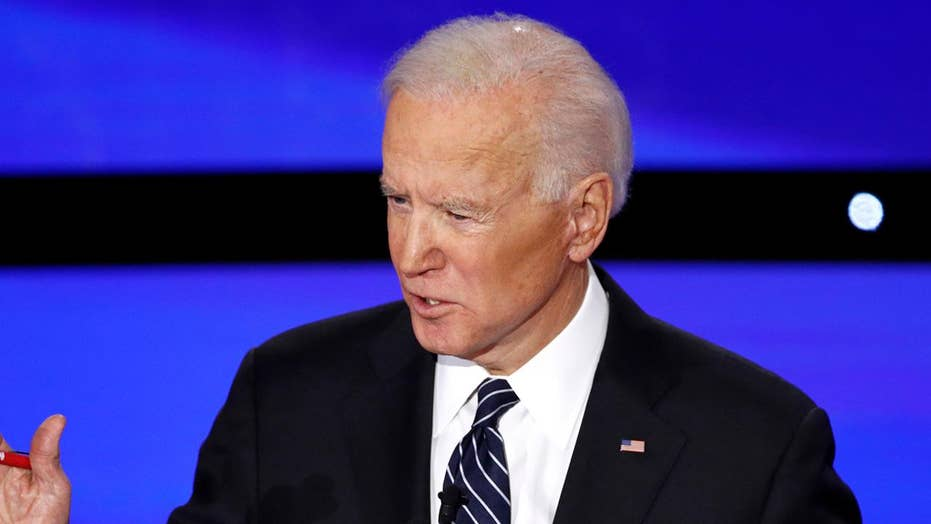 Biden touts record on climate change, Middle East