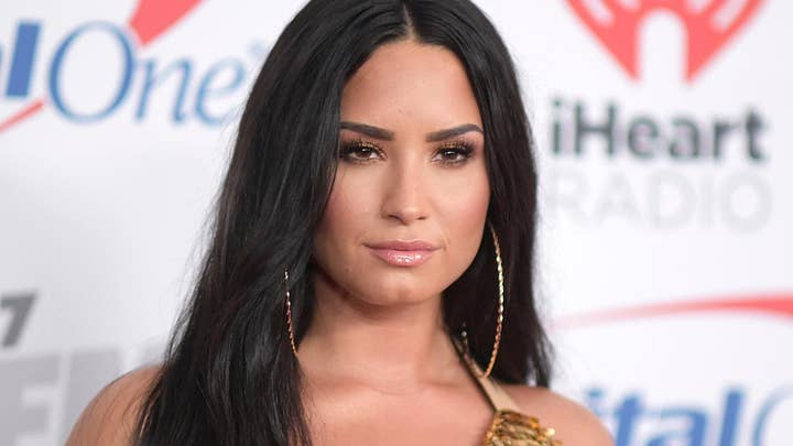 Demi Lovato is ready for some football; music legends to be honored