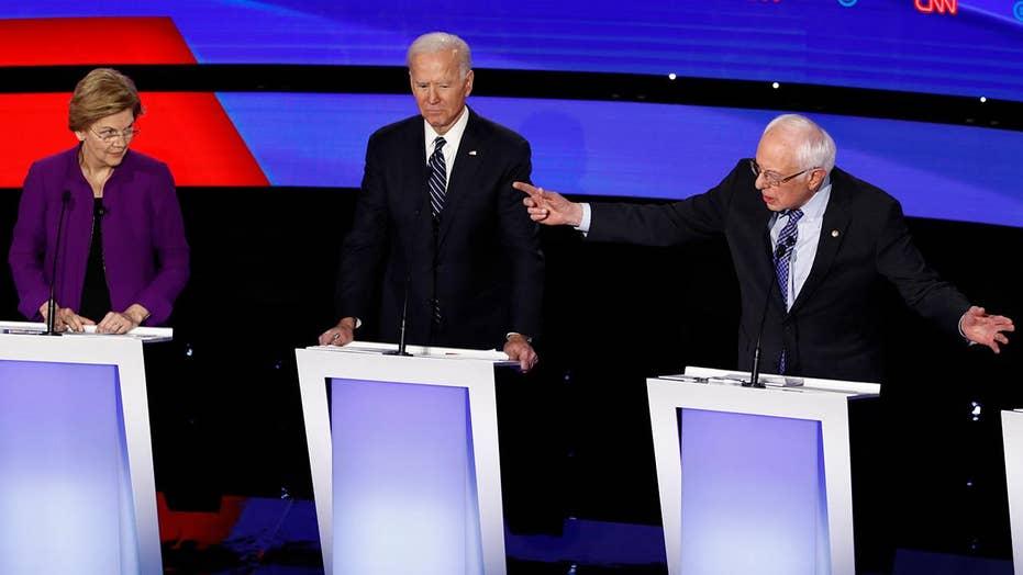 Hot mic captures tense exchange between Warren and Sanders