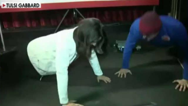 Tulsi Gabbard challenged to push-up contest during New Hampshire town hall