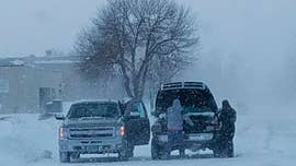 Bitter cold settles across Midwest in wake of sprawling storm; Northeast hit with snow, slush