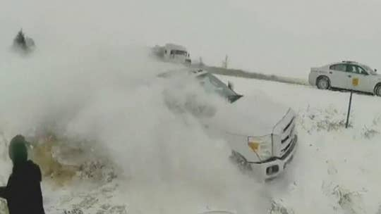Iowa police officer nearly hit by truck that slid off interstate in winter storm