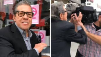 California storeowner accused of inappropriate behavior attacks local media in front of business