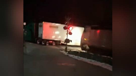 New York commuter train slams into tractor-trailer at railroad crossing