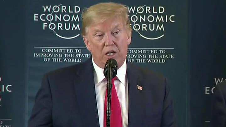 Trump wraps up Davos trip by slamming impeachment during press conference